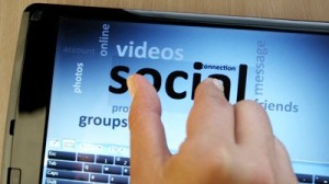 stock-footage-social-network-on-touch-screen-tablet-pc-with-finger-touching-screen-and-arranging-words